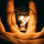 hand holding light lightbulb electricity energy